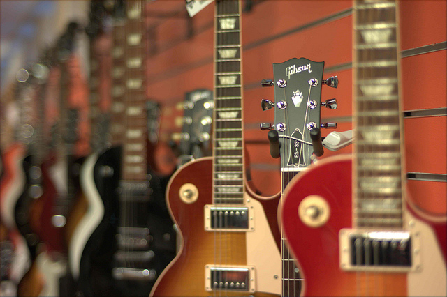 row of Les Paul Gibson guitars