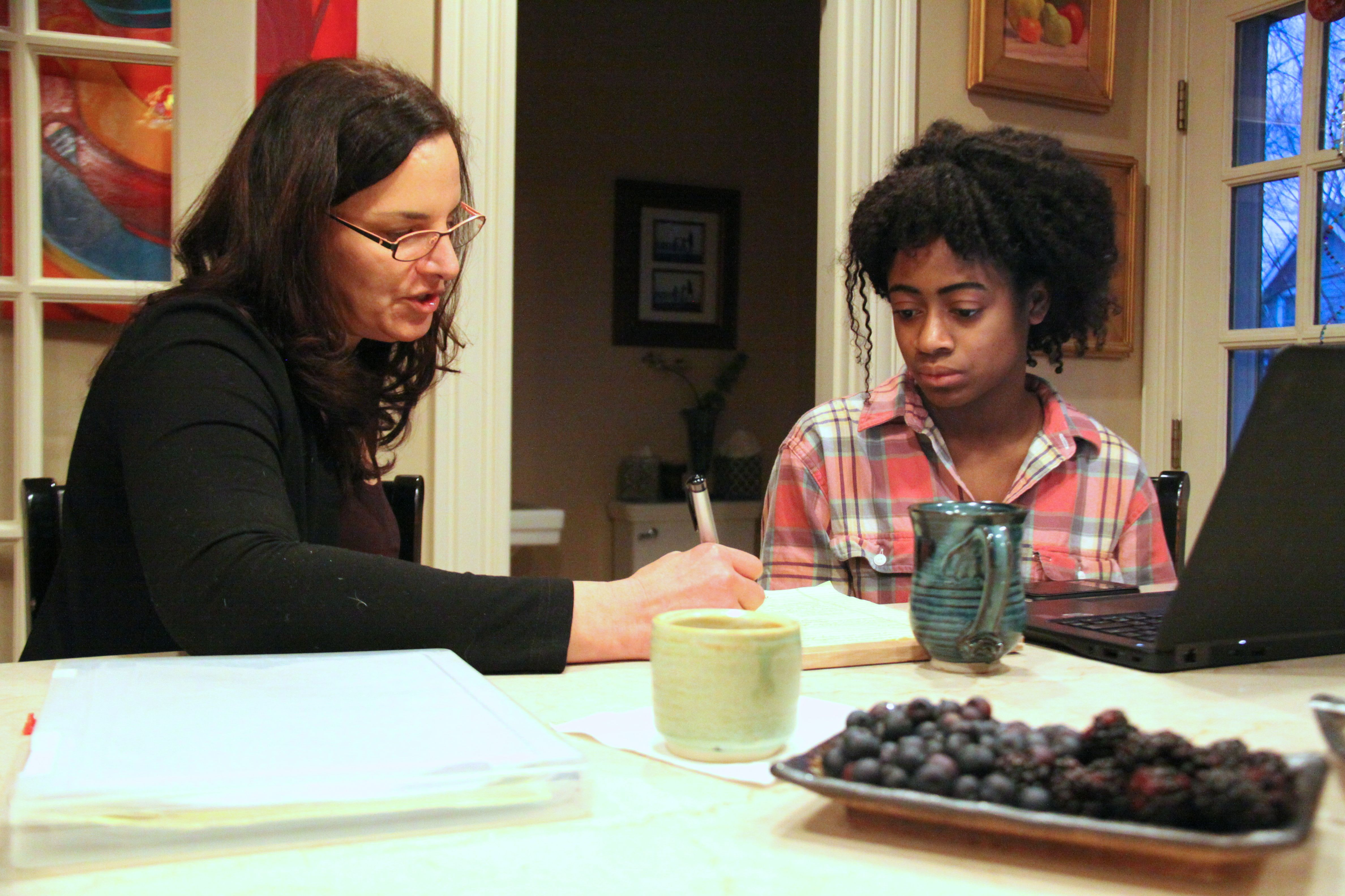 on campus how one affluent town helps its neediest students get newton north senior mirabelle espady and her mentor marsha kessler sit around the kitchen counter at kessler s newton home reviewing mirabelle s college