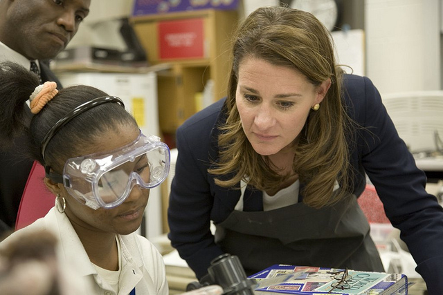 Melinda Gates watches a student