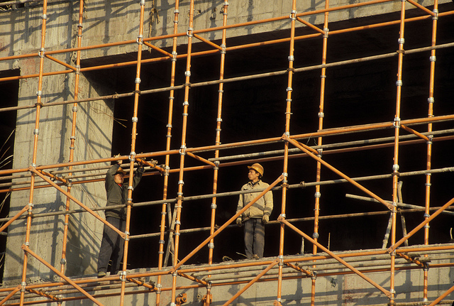 A worker stands at a construction site.