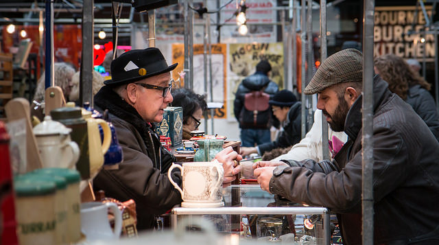 Two people negotiate at a market. Credit: Barney Moss / Flickr Creative Commons